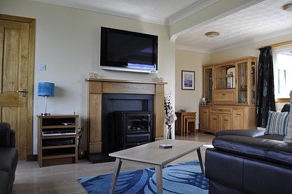 Pier House Self Catering Holiday Cottage Accomodation Elgol - the living room with fireplace and widescreen plasma TV